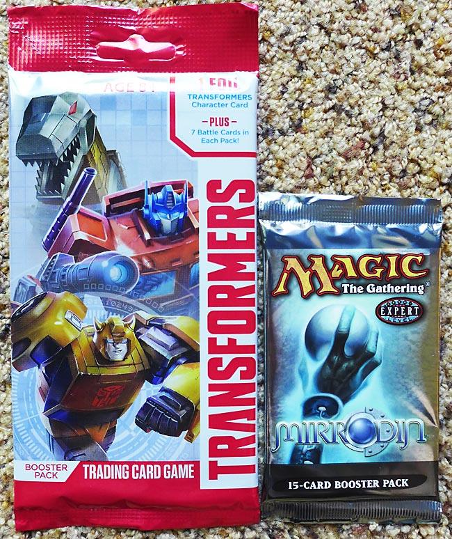 Transformers vs Magic: the Gathering Booster Pack Sizes